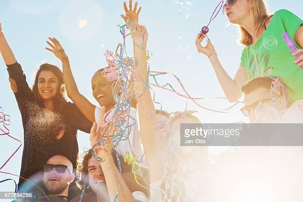 Lots of friends enjoying a beach party