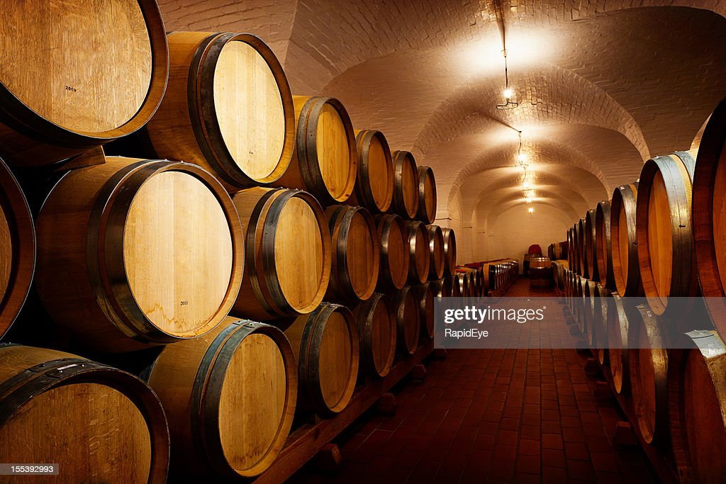 stacked oak barrels maturing red wine. Lots Of Future Wine! Oak Barrels Maturing In Winery Cellar : Stock Photo Stacked Red Wine