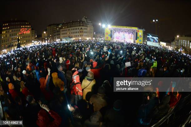 Lots of people stand in front of the stage during a concert for cosmopolitanism and tolerance at the Neumarkt in DresdenGermany 26 January 2015 The...