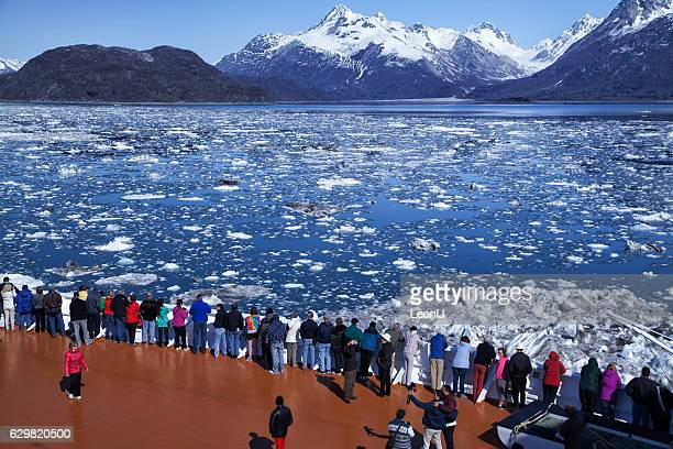 Lots of people watching glacier on a cruise ship, Alaska