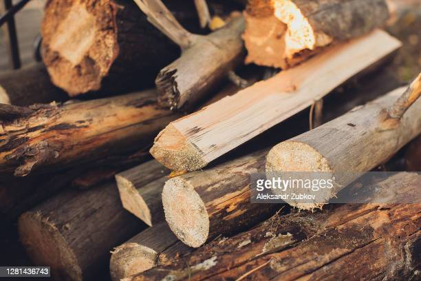 lots of wood. preparation of firewood for the winter. textured background. - chopping stock pictures, royalty-free photos & images
