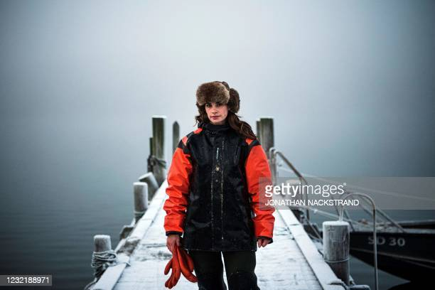 Lotta Klemming, a professional oyster diver, poses for photos after a dive at the quay near her family's company in Grebbestad in Vastra Gotaland...