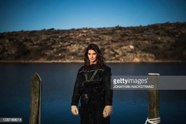 Lotta Klemming, a professional oyster diver, poses for photos prior to a dive at the quay near her familys company in Grebbestad in Vastra Gotaland...