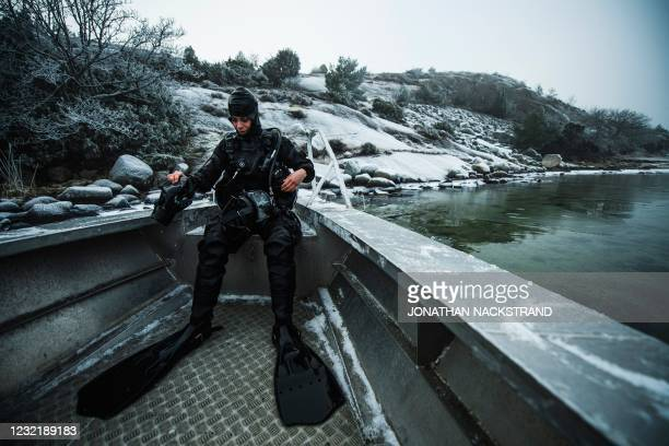 Lotta Klemming, a professional oyster diver, prepares for a dive, near her familys company in Grebbestad in Vastra Gotaland county on Swedens west...