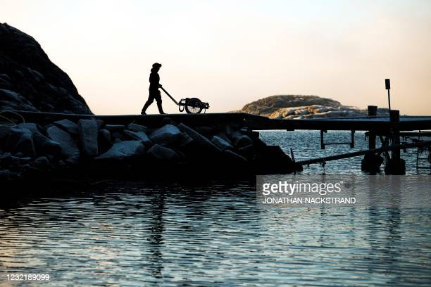 Lotta Klemming, a professional oyster diver, prepares her boat and equipment for a dive at the quay near her familys company in Grebbestad in Vastra...