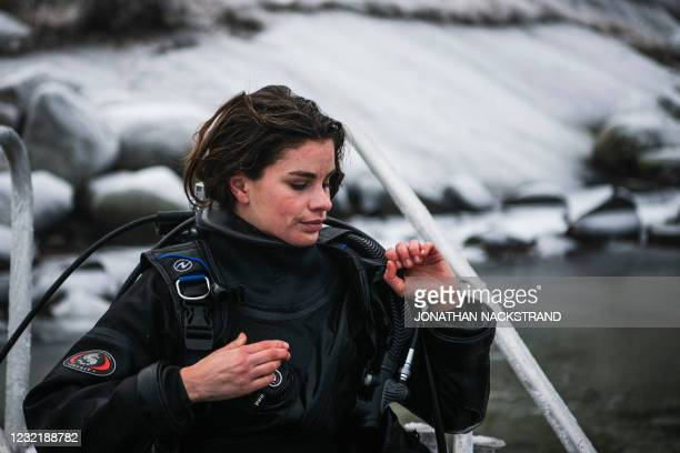 Lotta Klemming, a professional oyster diver, takes off her diving gear after collecting oysters, in the waters near her familys company in Grebbestad...