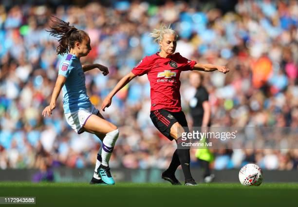 Lotta Okvist of Manchester United evades Tessa Wullaert of Manchester City during the Barclays FA Women's Super League match between Manchester City...