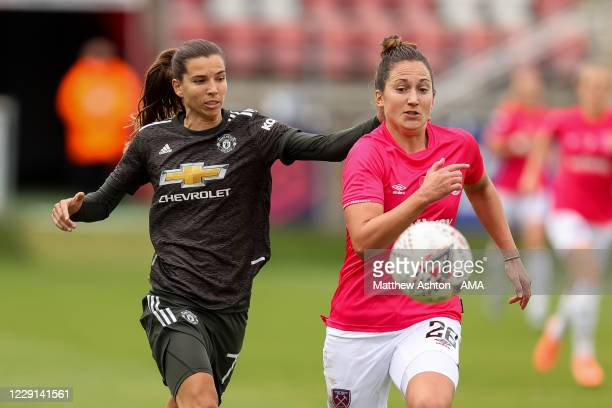 Lotta Okvist of Manchester United Women and Laura Vetterlein of West Ham United Women during the Barclays FA Women's Super League match between West...
