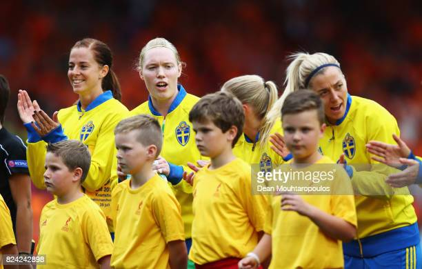 Lotta Schelin and Hedvig Lindahl of Sweden applaud after the national anthems during the UEFA Women's Euro 2017 Quarter Final match between...