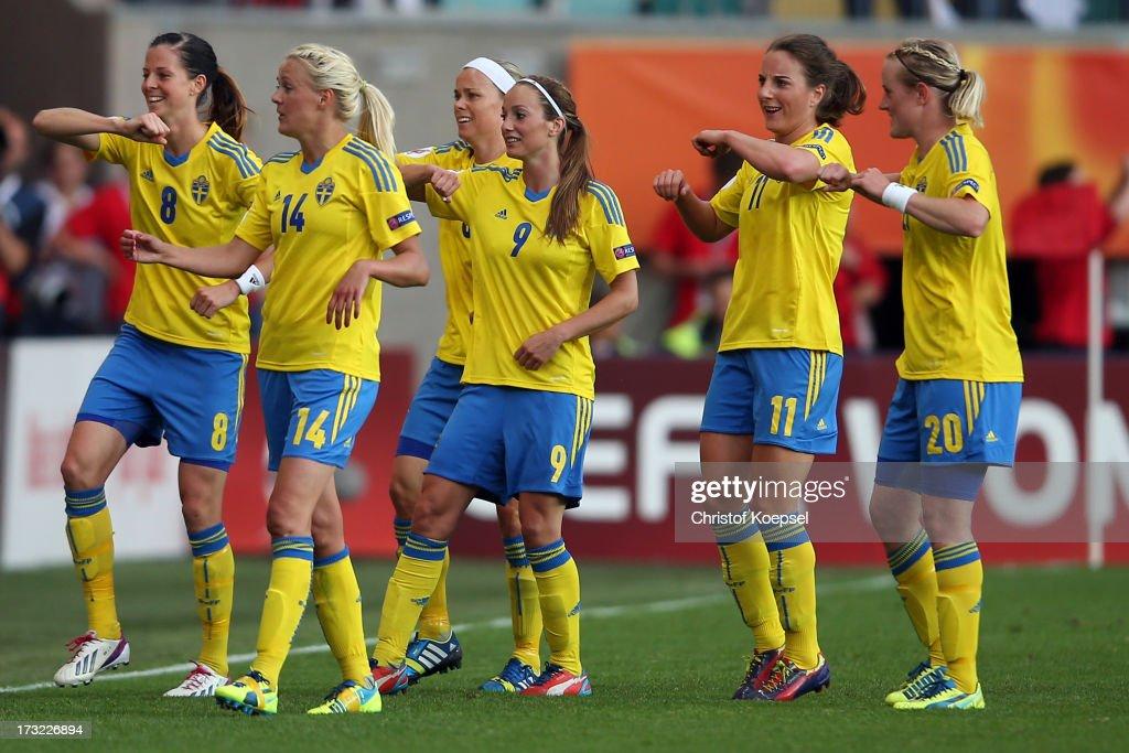 Lotta Schelin, Josefine Oeqvist, Nilla Fischer, Kosovare Asllani, Antonia Goeransson and Marie Hammarstroem of Sweden celebrate the first goal of Sweden during the UEFA Women's EURO 2013 Group A match between Sweden and Denmark at Gamla Ullevi Stadium on July 10, 2013 in Gothenburg, Sweden.