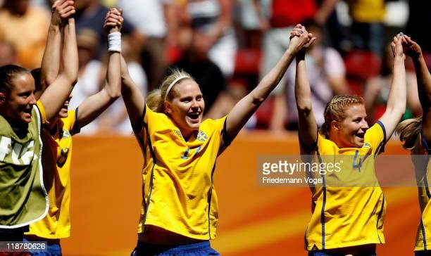 Lotta Schelin Lisa Dahlkvist and Annica Svensson of Sweden celebrate after winning the FIFA Women's World Cup 2011 Quarter Final match between Sweden...