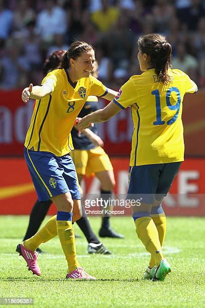 Lotta Schelin of Sweden and Madelaine Edlund of Sweden celebrate winning 31 the FIFA Women's World Cup 2011 Quarter Final match between Sweden and...