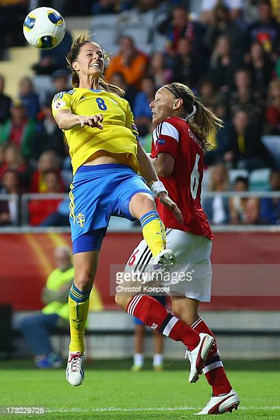 Lotta Schelin of Sweden and Mariann Knudsen of Denmark go up for a header during the UEFA Women's EURO 2013 Group A match between Sweden and Denmark...