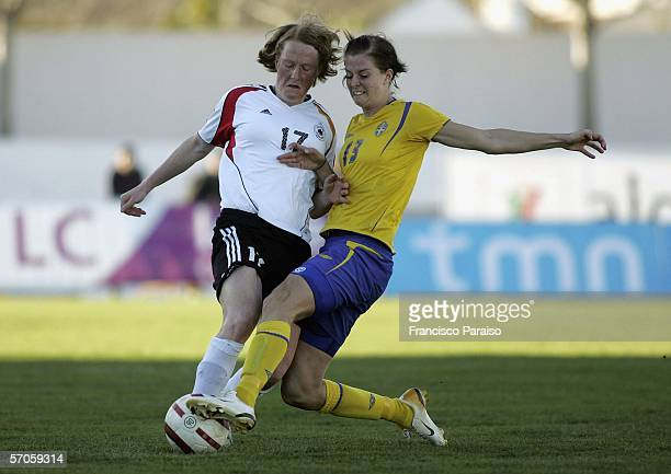 Lotta Schelin of Sweden and Melanie Behringer of Germany battle for the ball during the Womens Algarve Cup match between Germany and Sweden on March...