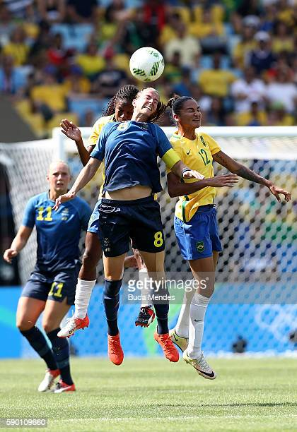 Lotta Schelin of Sweden and Poliana of Brazil in action during the Women's Football Semi Final between Brazil and Sweden on Day 11 of the Rio 2016...