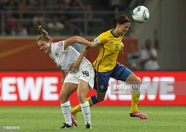 Lotta Schelin of Sweden and Rachel Buehler of USA battle for the ball during the FIFA Women's World Cup 2011 Group C match between Sweden and USA at...