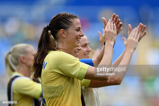 Lotta Schelin of Sweden applauds the crowd with team mates after the Women's Group E first round match between Sweden and South Africa during the Rio...
