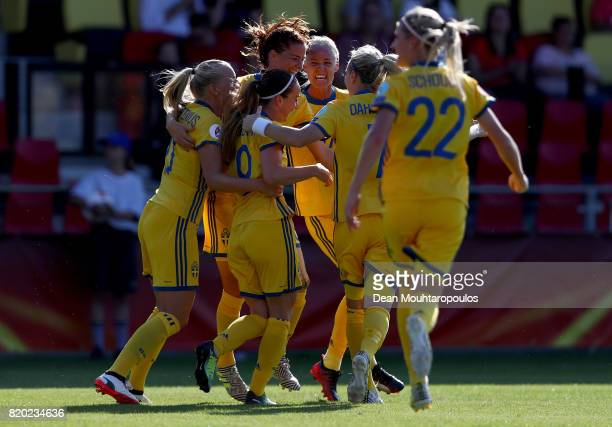 Lotta Schelin of Sweden celebrate with her team mates after she heads the opening goal during the Group B match between Sweden and Russia during the...