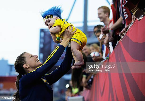 Lotta Schelin of Sweden celebrates with a young fan after the Group D match between United States of America and Sweden of the FIFA Women's World Cup...