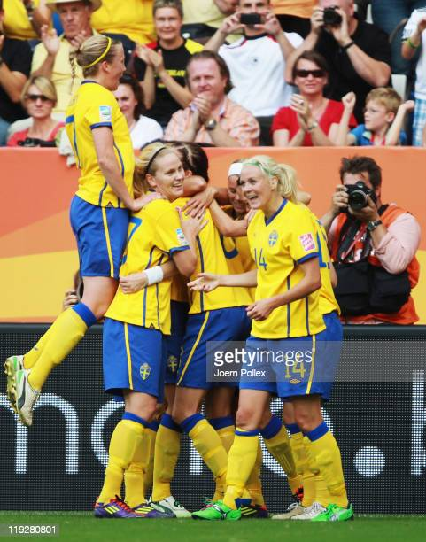 Lotta Schelin of Sweden celebrates with her team mates after scoring her team's first goal during the FIFA Women's 3rd Place Playoff match between...