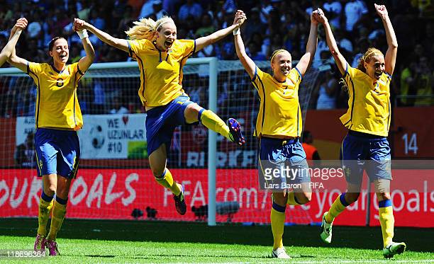 Lotta Schelin of Sweden celebrates with Lisa Dahlkvist Sara Larsson and Charlotte Rohlin after winning the FIFA Women's World Cup 2011 Quarter Final...