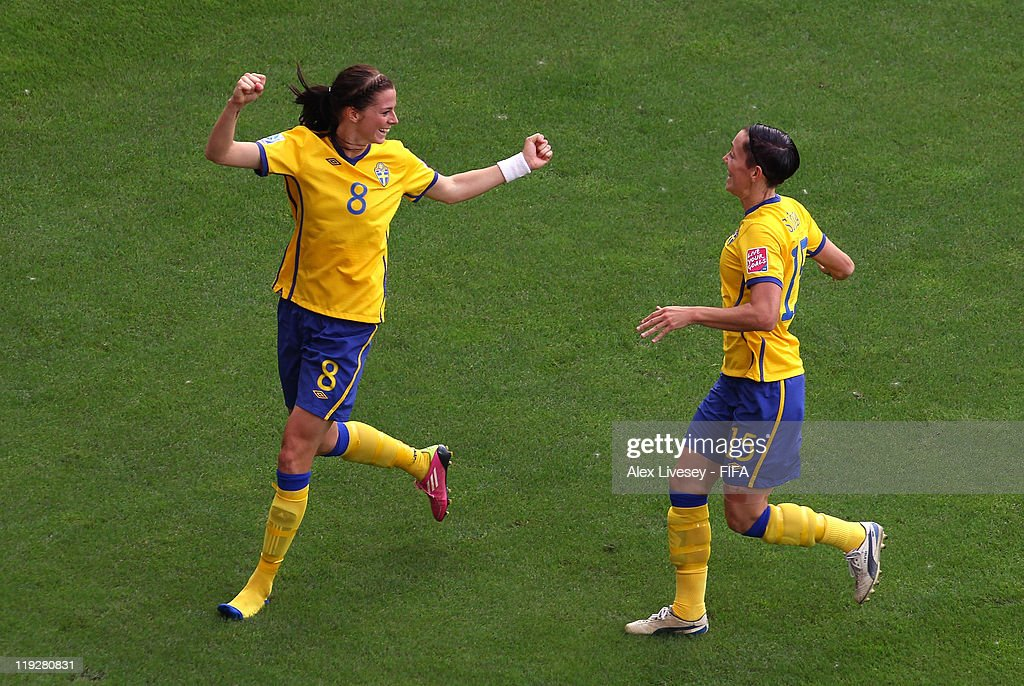Lotta Schelin of Sweden celebrates with Therese Sjogran after scoring the opening goal during the FIFA Women's World Cup 3rd Place Playoff between Sweden and France at Rhein-Neckar Arena on July 16, 2011 in Sinsheim, Germany.