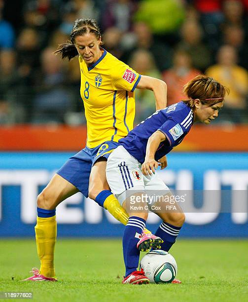 Lotta Schelin of Sweden challenges Nahomi Kawasumi of Japan during the FIFA Women's World Cup Semi Final match between Japan and Sweden at the FIFA...