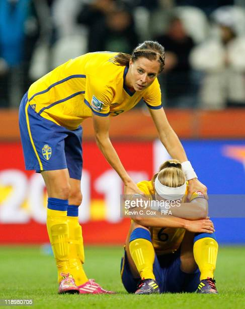 Lotta Schelin of Sweden consoles Sara Thunebro after their 31 loss to Japan in the FIFA Women's World Cup Semi Final match between Japan and Sweden...