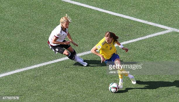 Lotta Schelin of Sweden controls the ball against Saskia Bartusiak of Germany during the FIFA Women's World Cup Canada 2015 round of 16 match between...