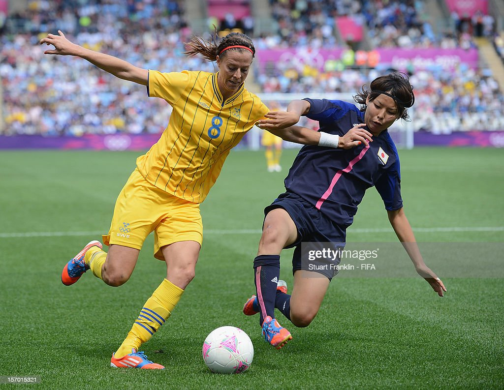 Lotta Schelin of Sweden is challenged by Saki Kumagai of Japan during the Women's Football first round Group F Match of the London 2012 Olympic Games between Japan and Sweden at City of Coventry Stadium on July 28, 2012 in Coventry, England.