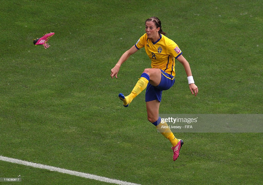 Lotta Schelin of Sweden kicks her boot off as she celebrates after scoring the opening goal during the FIFA Women's World Cup 3rd Place Playoff between Sweden and France at Rhein-Neckar Arena on July 16, 2011 in Sinsheim, Germany.