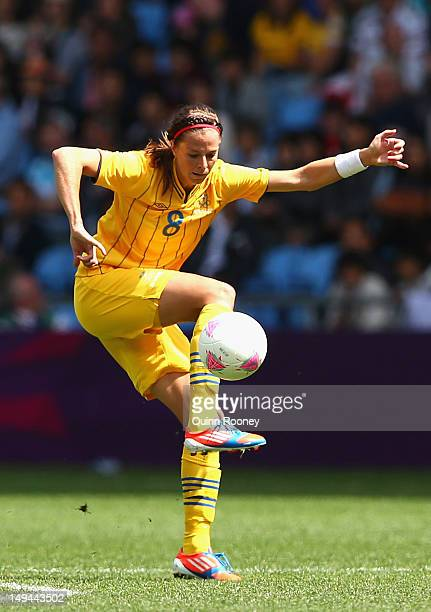 Lotta Schelin of Sweden looks to pass the ball during the Women's Football first round Group F Match of the London 2012 Olympic Games between Japan...