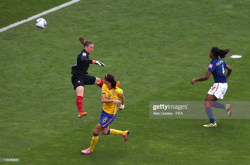 Lotta Schelin of Sweden scores past Berangere Sapowicz of France for the opening goal during the FIFA Women's World Cup 3rd Place Playoff between Sweden and France at Rhein-Neckar Arena on July 16, 2011 in Sinsheim, Germany.