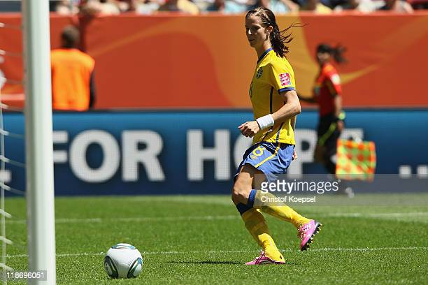 Lotta Schelin of Sweden scores the third goal during the FIFA Women's World Cup 2011 Quarter Final match between Sweden and Australia at the FIFA...