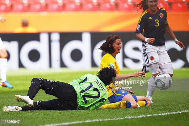 Lotta Schelin of Sweden tries to score against goalkeeper Sandra Sepulveda and Natalia Gaitan of Colombia during the FIFA Women's World Cup 2011...