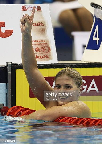 Lotte Friis of Denmark celebrates winning the gold medal in the Women's 1500m Freestyle Final during Day Eleven of the 14th FINA World Championships...
