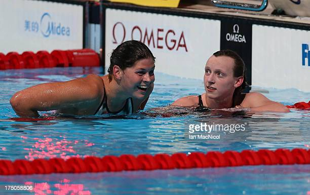 Lotte Friis of Denmark congartulates Katie Ledecky of USA who set a a new world record and wins the final of The Women's 1500m Freestyle at the Palau...