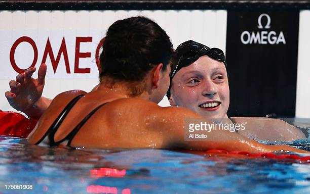 Lotte Friis of Denmark expresses congratulations to Katie Ledecky of the USA after she sets a new World Record time of 153653 during the Swimming...