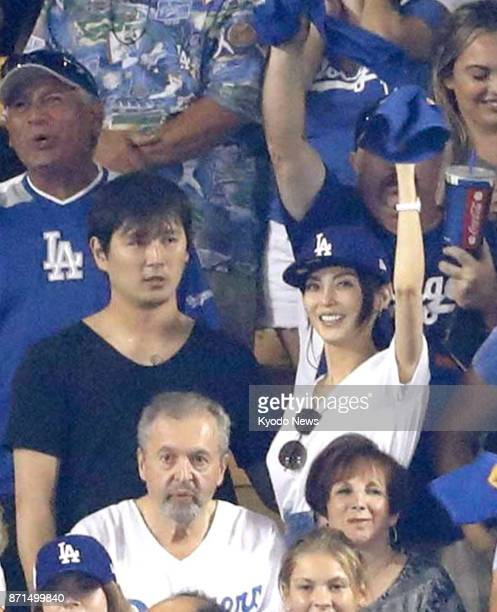 Lotte Marines righthander Hideaki Wakui watches the World Series between the Los Angeles Dodgers and the Houston Astros at Dodger Stadium with his...