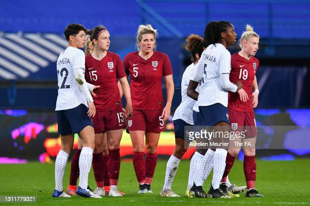 Lotte Wubben-Moy, Millie Bright and Beth England of England prepare to attack a corner-kick during the International Friendly Match between France...