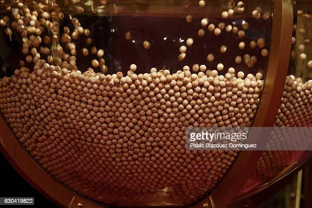 Lottery ball bearings are dropped into a giant glass ball during the draw of Spain's Christmas lottery named 'El Gordo' at the Teatro Real on...