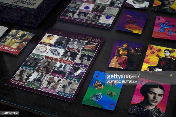 A lottery board game with the image of late Mexican artist Frida Kahlo are exhibited alongside other commercial products at her sister's house in the...