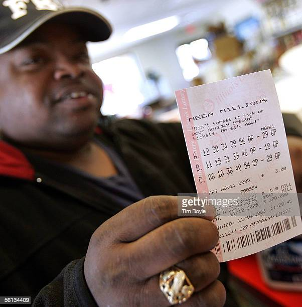 Lottery player Art Miles displays what he says are the winning numbers after buying his Mega Millions lottery ticket at a gas station which is...