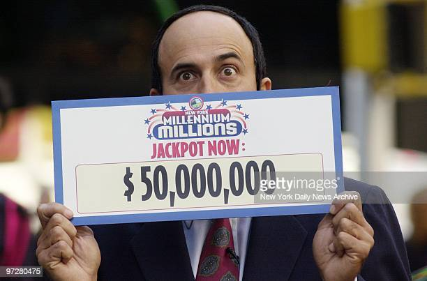 Lottery spokesman Ralph Buckley announces the new $50 million Millenium Millions jackpot in Time Square