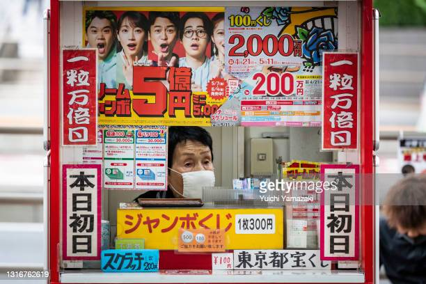 Lottery stand staff wearing a face mask waits for a customer on May 07, 2021 in Tokyo, Japan. Prime Minister Yoshihide Suga announced today that the...