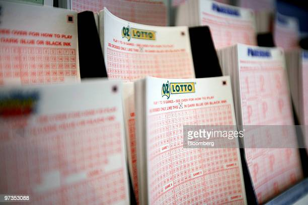 Lottery ticket forms are arranged for display at a New South Wales Lotteries Corp retail outlet in Sydney Australia on Tuesday March 2 2010 Tatts...