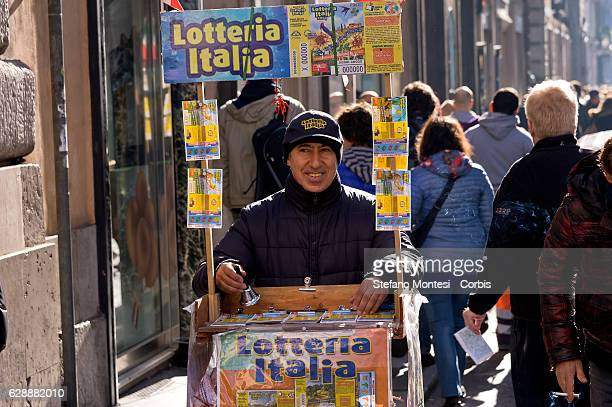 A lottery tickets seller offers tickets on the 'Via del Corso' on December 8 2016 in Rome Italy