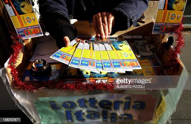 A lottery tickets seller shows tickets in a street of Rome on December 12 2012 AFP PHOTO / ALBERTO PIZZOLI