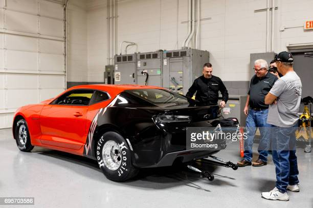 Lottery winner Kevin Mitchell center views his new General Motors Co Chevrolet COPO Camaro inside the company's build center in Oxford Michigan US on...