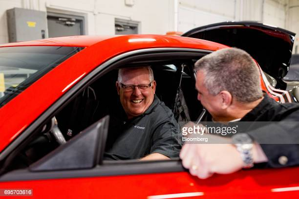 Lottery winner Kevin Mitchell left smiles while sitting inside his new General Motors Co Chevrolet COPO Camaro performance vehicle during a tour of...
